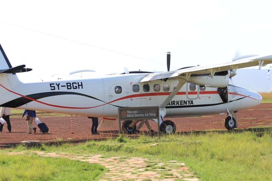 Small ten seat plane land on private air strip Serena Lodge